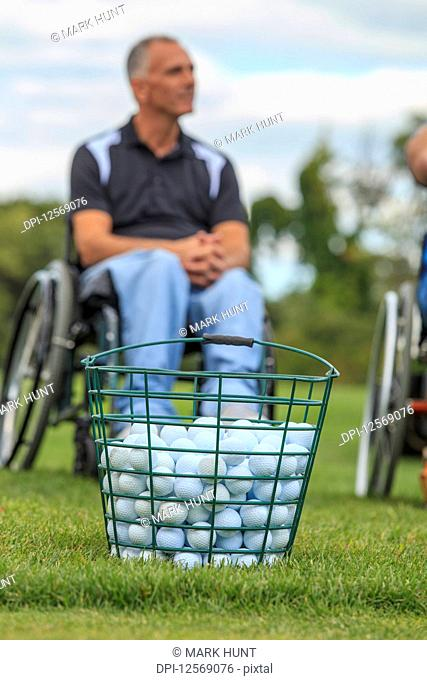 Man in wheelchair with spinal cord injuries waiting to play golf