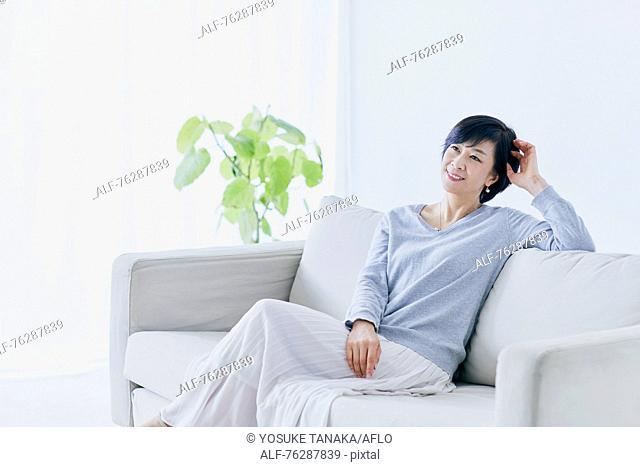 Japanese senior woman on sofa