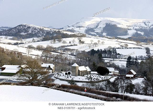 Saint david's Church and the tiny Welsh hamlet of Llanddewi'r Cwm are seen in a winter landscape, Powys, UK
