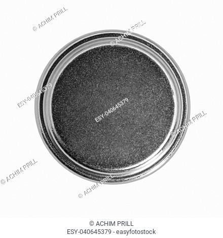 studio photography of a button cell battery isolated in white back