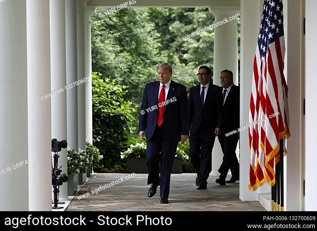 United States President Donald J. Trump, left, arrives to deliver remarks on China in the Rose Garden at the White House in Washington, DC on May 29, 2020