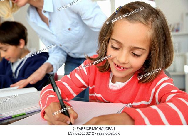 Portrait of beautiful little girl in class