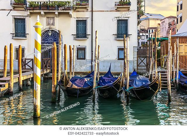 Gondolas, a pier in front of the palace and a typical venetian backyard, Venice, Italy