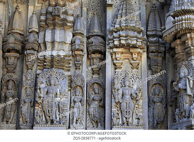 Close up of Deity sculpture on shrine outer wall in the Chennakesava Temple, Hoysala Architecture at Somanathpur, Karnataka, India