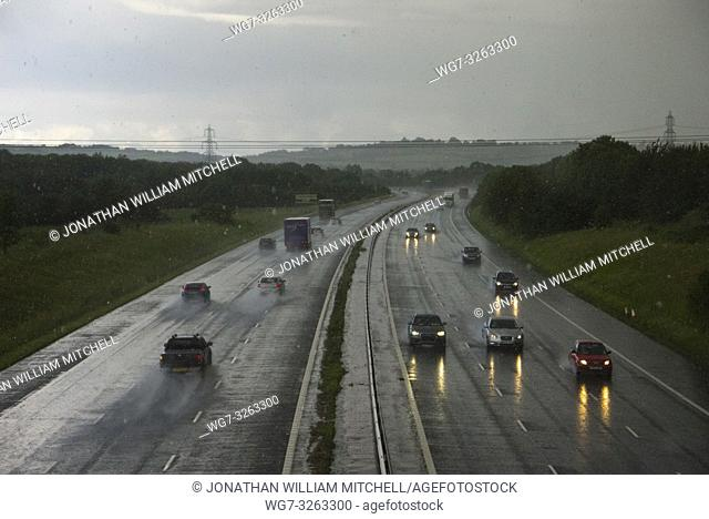 UK Oxfordshire -- 11 Jul 2012 -- Traffic on the M40 in Oxfordshire during a heavy hailstorm. Heavy showers have made for difficult driving conditions as...