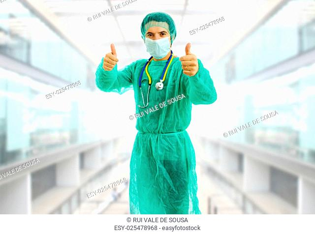 young male doctor going thumbs up at the hospital