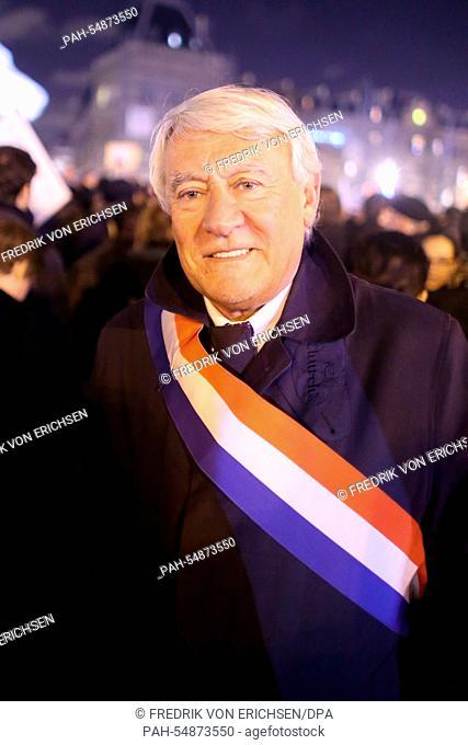 Claude Goasguen (UDF, Union pour la démocratie française) demonstrates and wears a sash bearing the French national colours (blue, white