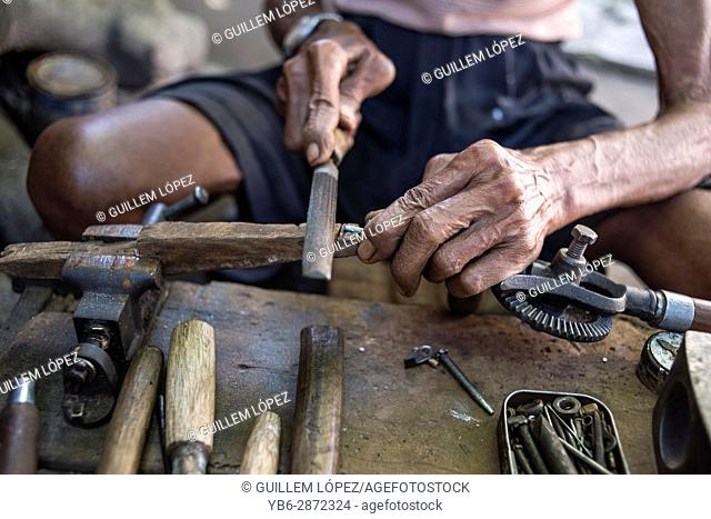 Senior Carpenter at work in his workshop in Yogyakarta, Java, Indonesia