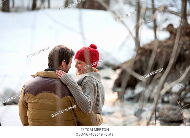 Portrait of smiling couple in snow