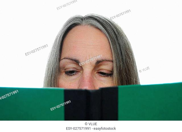 Woman reading a green hardcover book isolated on white background with room for your text