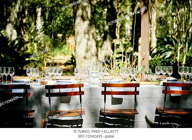 A table laid under trees