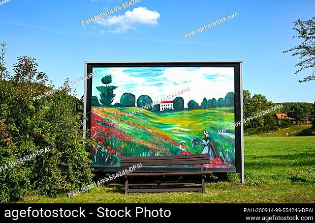 12 September 2020, Hessen, Braunsen: Since 2017, a painting by the artist couple Gunter and Carmen Best showing a landscape has adorned a former billboard near...