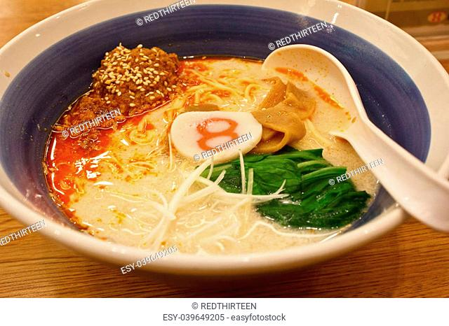 pork bone soup noodle with spicy ground pork garnished with Japanese spring onion, pak choi, kamaboko, sesame seeds and memma