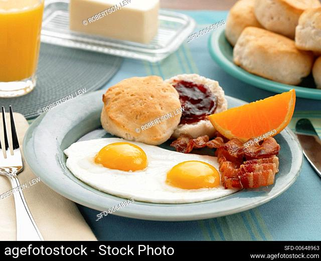 Two Eggs Over Easy with Bacon and a Biscuit with Jam