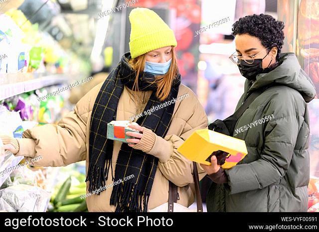 Female friends wearing warm clothing in supermarket