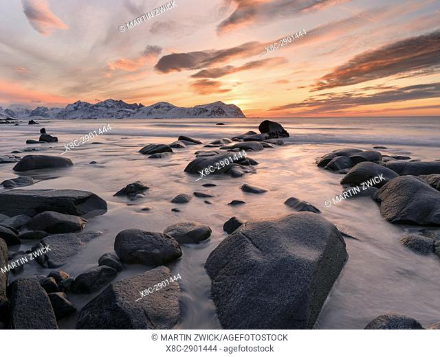 Beach near Vikten on the island Flakstadoya. In the background the mountains of the island Moskenesoya. The Lofoten Islands in northern Norway during winter