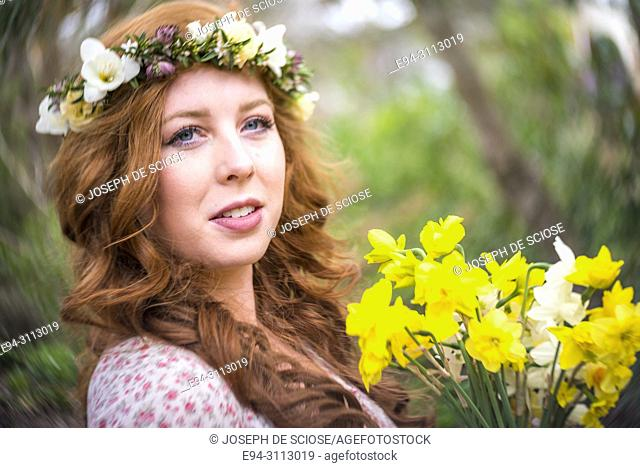 A portrait of a pretty 25 year old redheaded woman smiling at the camera