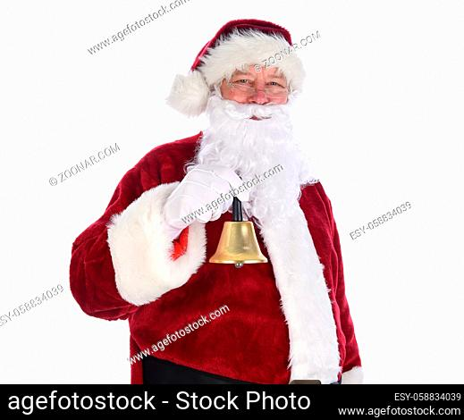Closeup of Santa Claus holding a gold bell ringing in the holidays