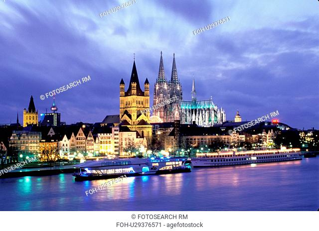 Cologne, Koln, Germany, Nordrhein-Westfalen, Rhine River, Europe, Scenic view at night of the city of Cologne (Koln) and the Cologne Cathedral (Dom) along the...