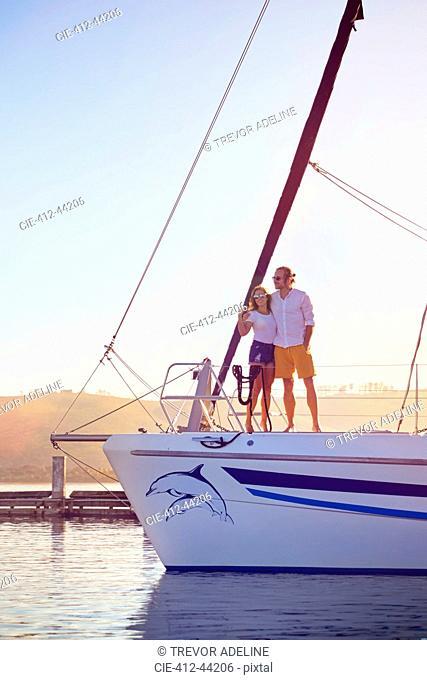 Couple hugging on catamaran