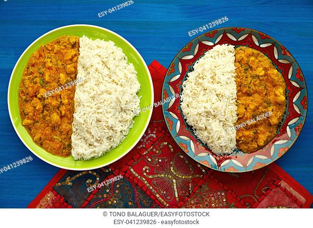 Chicken curry dish indian recipe on blue table
