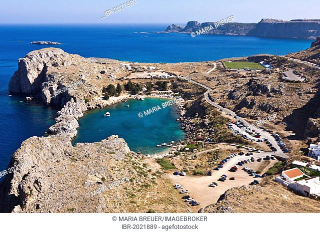 St Paul's Bay near Lindos, with parking area, Lindos, Rhodes, Greece, Europe