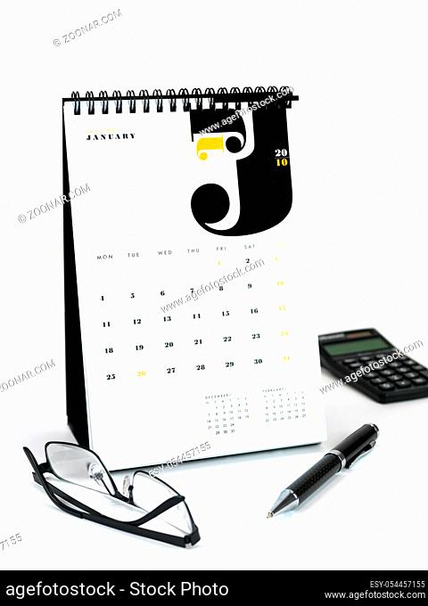 A desk calendar isolated against a white background