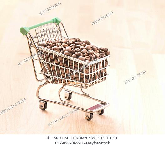 Shopping cart full of roasted coffee beans