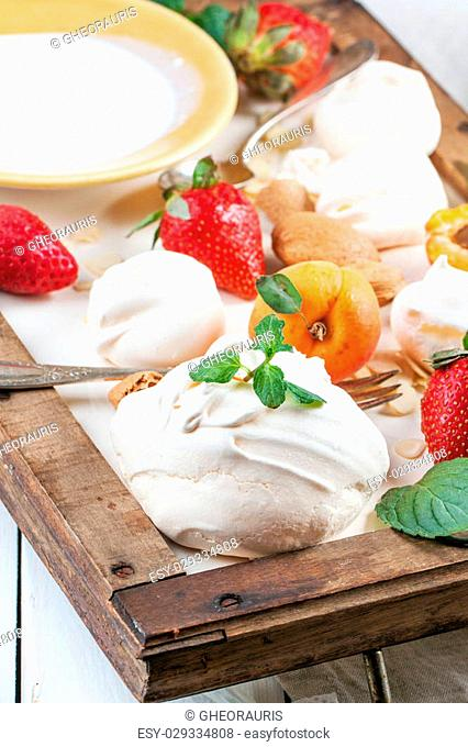 Homemade meringue with apricots, strawberries, almonds and cream. Ingredients for dessert Eton mess