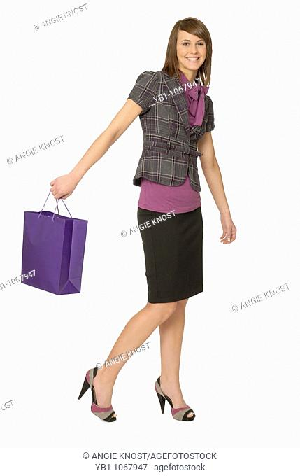 Teenage girl / young adult with shopping bags