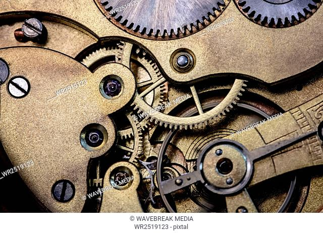 Old pocket watch machine with gears