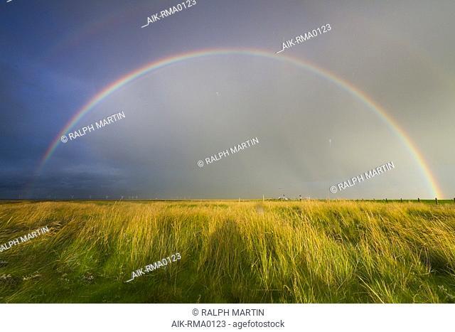 Rainbow over the Wadden Island Hamburger Hallig in Germany