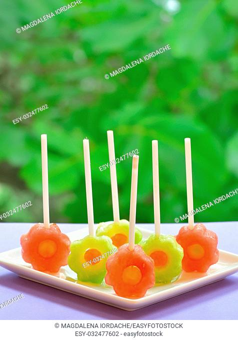 yellow and red watermelon lollipop