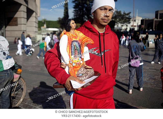 A pilgrim holds an image of Saint Juan Diego at the pilgrimage to Our Lady of Guadalupe Basilica in Mexico City, Mexico, December 10, 2013