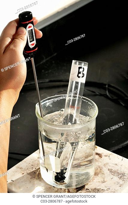 A beaker of water and a numbered test tube containing an unknown metal are heated on a hot plate in a San Clemente, CA, high school chemistry lab calorimetry...