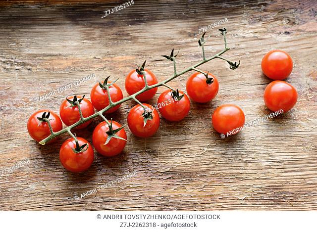 cherry tomatoes on a wooden background