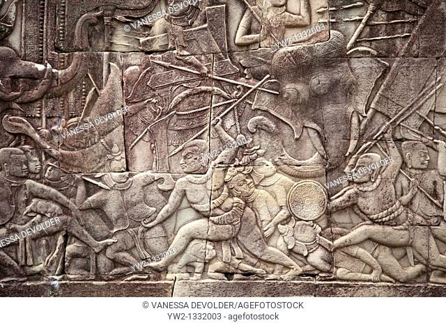 Stone-carved bas relief at Angkor, Bayon temple, Cambodia