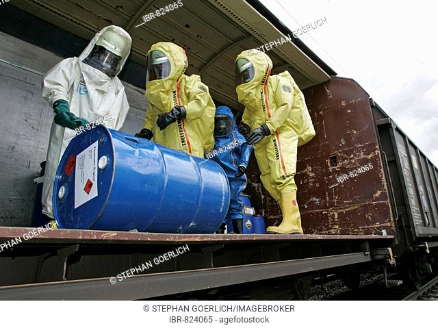 Firemen wearing hazmat suits at work during a disaster control drill, near Poing, Bavaria, Germany, Europe