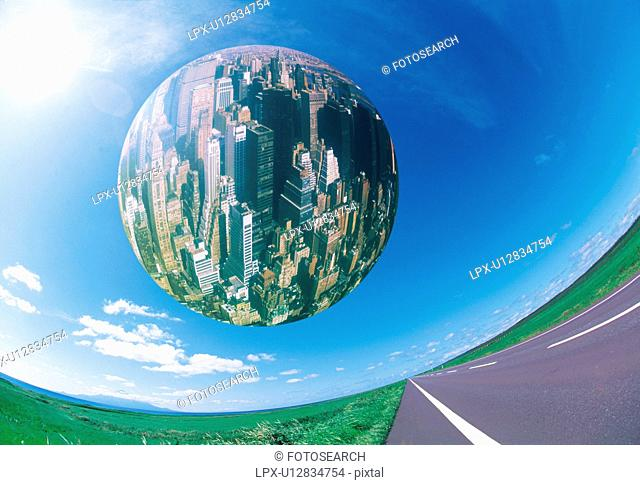 Sphere floating over driveway, view of New York city in the sphere, computer graphic, fish-eye lens