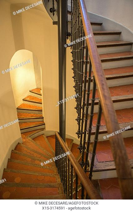 A winding staircase in the Hotel la Bellaudere in Grasse, France, lead guests to their rooms and past the entrance to what was once the living quarters of...