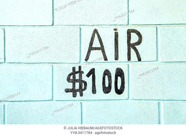 The world Air with a price painted on a brick wall
