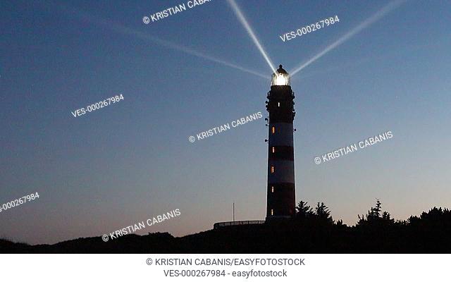 Lighthouse with turning beam, Amrum, Northfrisian Islands, Schleswig-Holstein, Germany, Europe