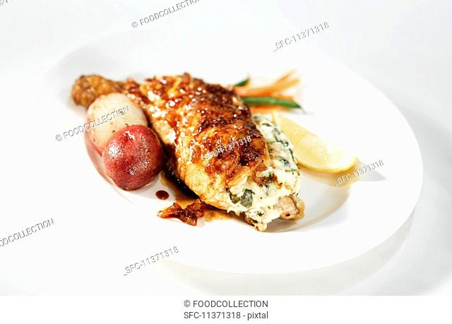 Chicken legs filled with cream cheese with an onion sauce