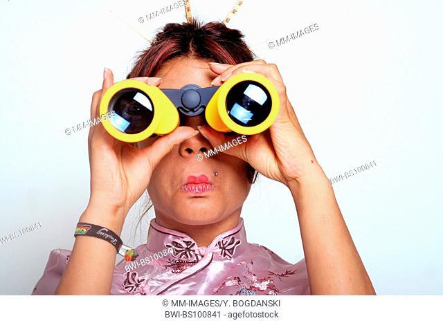 woman looking through a binocular, Germany