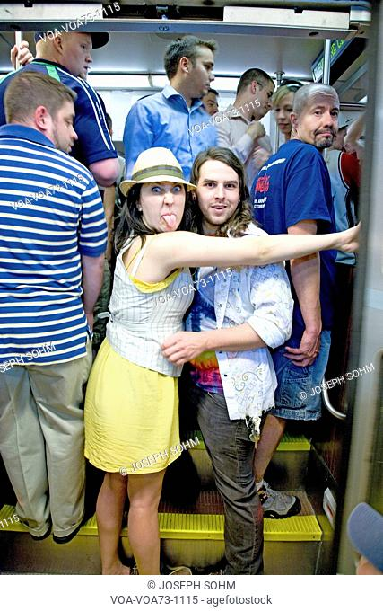 Girl sticks tongue at photographer from train going to Fenway Park, Boston, Ma., USA