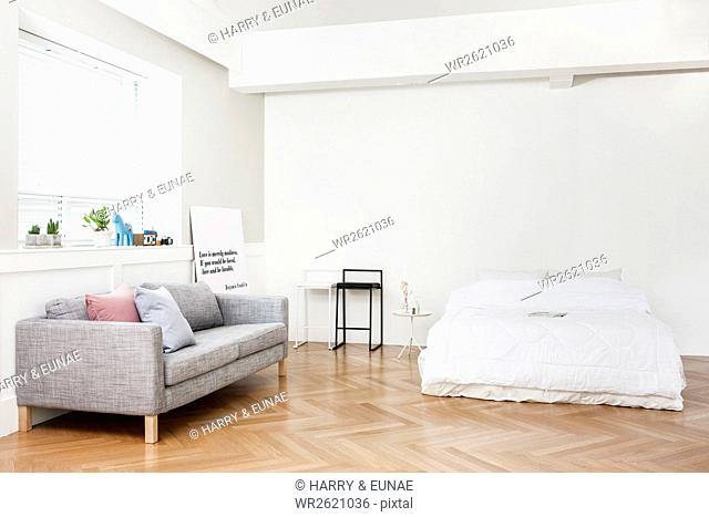 Interior with sofa and bed