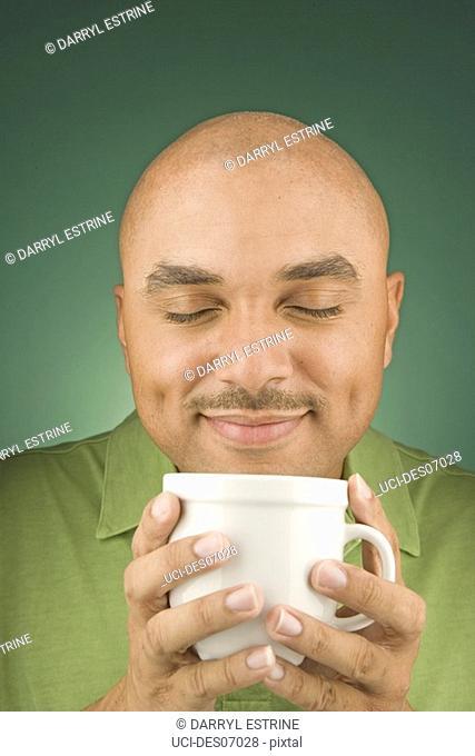 Young man holding mug