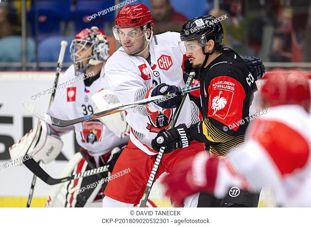 From left hockey players of Mountfield BRANDON MAXWELL, PETR ZAMORSKY and FABIEN COLOTTI of Rouen in action during the Ice hockey Champions League matches group...