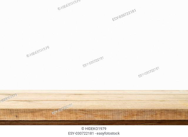 Empty wooden table for product placement or montage with focus to the table top in the foreground, with white background