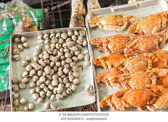 Fresh clams and crabs at a Thai market